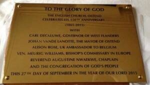 Brass wall plaque commemorating 150th anniversary of church
