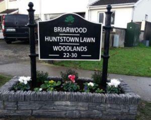 Cast housing estate sign