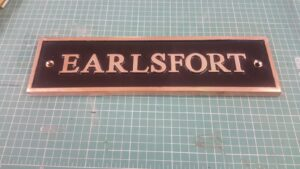 house nameplate in cast bronze