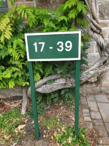 green and white housing estate house numbers