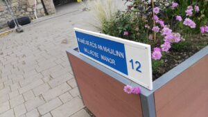 blue and white cast housing estate name of block