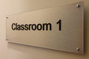 Classroom door sign with braille