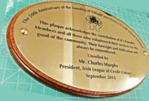 Brass Wall Plaque on Mahogany