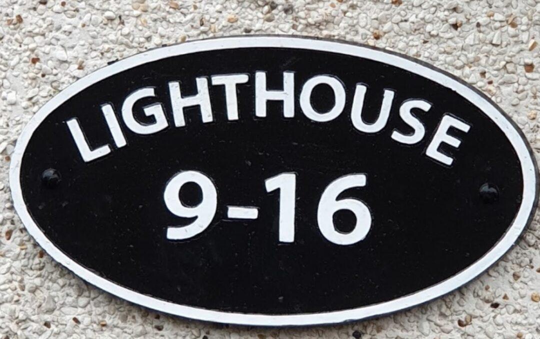 apartment block cast sign