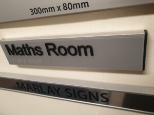 Acrylic door signs with braille