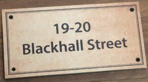 Antique effect sign for apartment block
