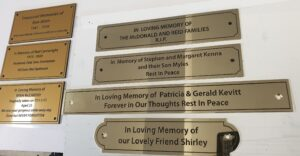 Memorial signs in gold acrylic