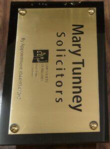 Brass plaque on hardwood