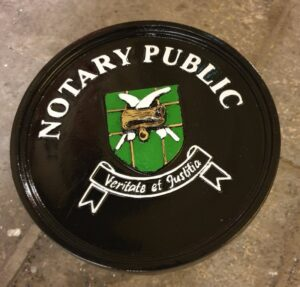 Cast black and green notary public plaque