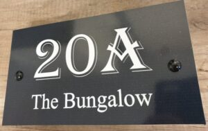 House sign with name and number black and white