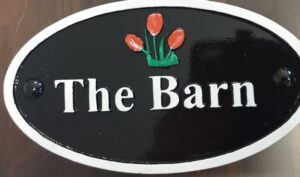 Cast house sign with name and logo