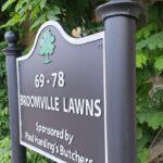 Cast metal housing estate signs